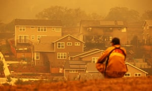 A firefighter looks towards a home that was destroyed by the Glass incident fire on Tuesday in Santa Rosa, California.