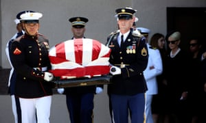 John McCain's casket is carried out of the North Phoenix Baptist church on Thursday.