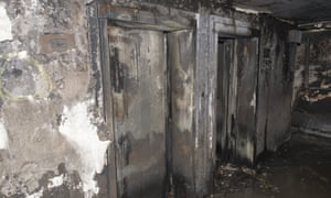 In this photo released by the Metropolitan Police on Sunday, June 18, 2017, burnt out lifts on an undisclosed floor, in the Grenfell Tower after fire engulfed the 24-storey building, in London. Experts believe the exterior cladding, which contained insulation, helped spread the flames quickly up the outside of the public housing tower early Wednesday morning. Some said they had never seen a building fire advance so quickly. The 24-story tower that once housed up to 600 people in 120 apartments is now a charred ruin. (Metropolitan Police via AP)