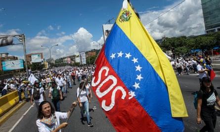 Demonstrators challenge the government in Caracas, Venezuela, on Monday.