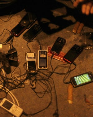 Egyptian protesters charge their phones in Tahrir Square.