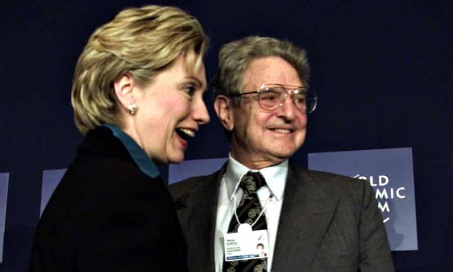 Head shot of George Soros with then New York senator Hillary Clinton at the World Economic Forum in 2002
