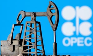 A 3D printed oil pump jack is seen in front of displayed Opec logo.