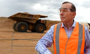 Prime Minister Tony Abbott looks on during a demonstration at the opening of the Caval Ridge Coal Mine near Moranbah in central Queensland, Monday, Oct. 13, 2014. The BMP (BHP Billiton Mitsubishi Alliance) mine will produce 5.5 million tones per annum of premium quality metallurgical coal. (AAP Image/Dan Peled) NO ARCHIVING