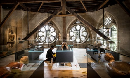 A member of staff cleans the cabinet containing the funeral effigy of James I in the Queen's Diamond Jubilee Galleries in the revamped triforium space.