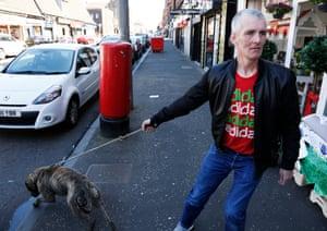 Barry O' Hara and his dog Caesar on Shettleston Road.