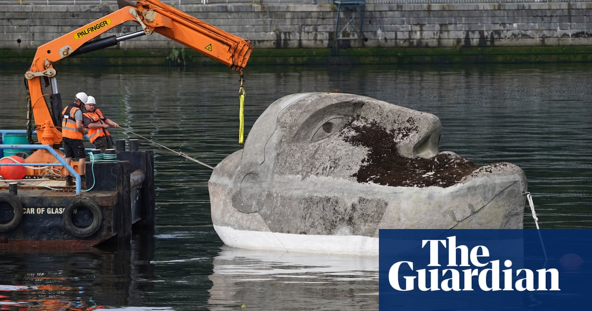 Three-decade-old Floating Head sculpture revived in Glasgow