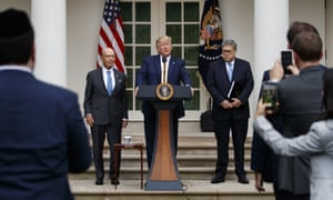 Trump, flanked by the commerce secretary, Wilbur Ross and the attorney general, William Barr, discusses the census.