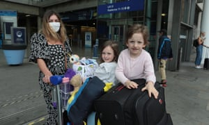 Carina Ignatiuc and her daughters, Abigail and Imogen arriving on the first Eurostar of the day from France following the government's quarantine announcement.