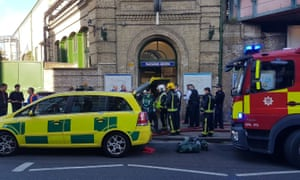 Emergency services attend the scene following a blast on an underground train at Parsons Green station in West London.