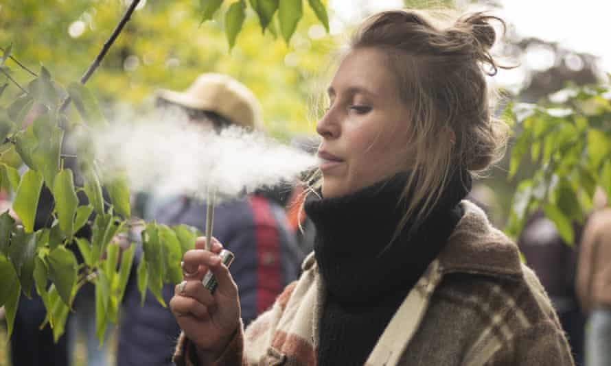 A woman smokes a marijuana cigarette in Toronto. A mix of retail chain distribution and logistical kinks have created fertile ground for the shortages.