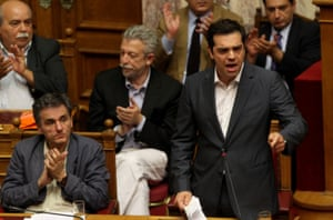 Greek Parliament agrees on bailout deal, Athens, Greece - 15 Jul 2015<br>Mandatory Credit: Photo by Xinhua/REX Shutterstock (4903851h) Alexis Tsipras addresses the Greek Parliament before voting Greek Parliament agrees on bailout deal, Athens, Greece - 15 Jul 2015 Tsipras on Wednesday called on his radical left Syriza party parliamentary group to remain united in critical times for the country, amid a string of anti-austerity strikes and protests. With a Syriza rebellion, the final outcome was a majority 'yes' to the measures.