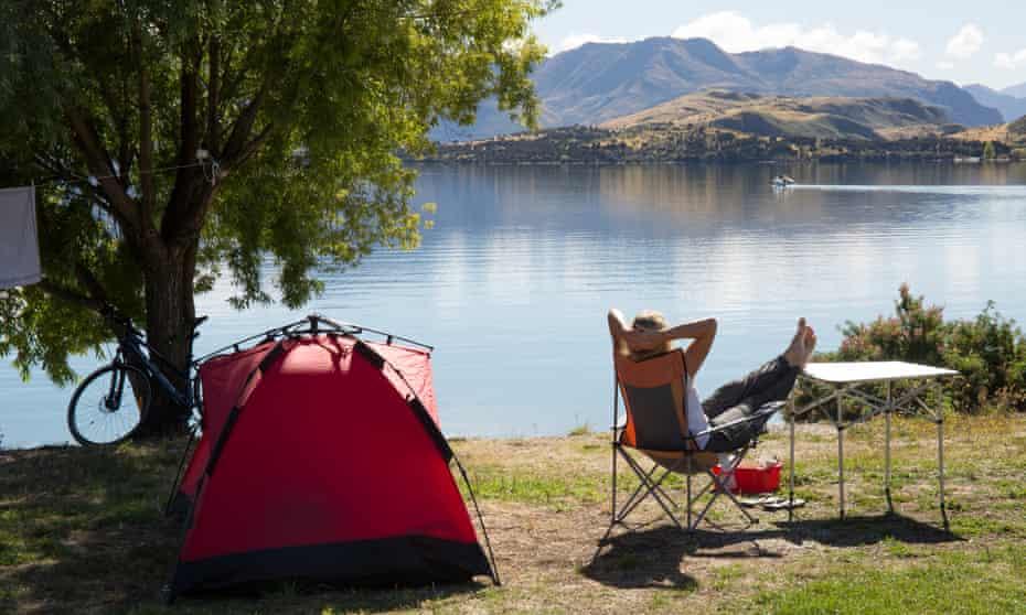 Woman camping by a lake