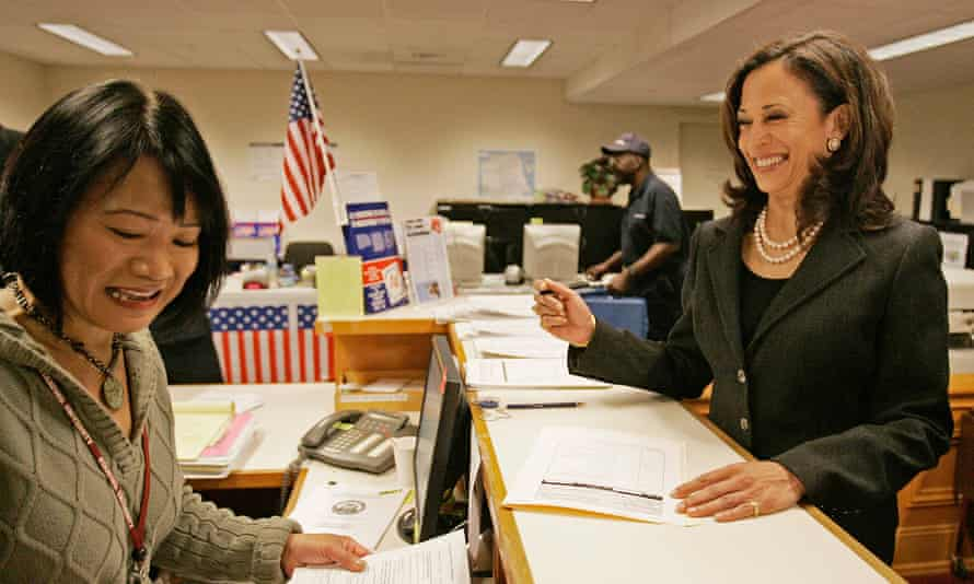District Attorney Kamala Harris, right, smiles at Coni Binaley, left, campaign services coordinator, as she prepares to sign election papers Wednesday, Nov. 12, 2008, at city hall in San Francisco.