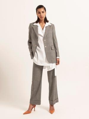 model wears blazer, £135, and trousers, £89, both arket.com. Poplin wrap shirt, £65, topshop.com. Shoes, £89, kurtgeiger.com.