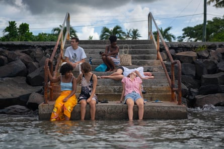My friends rest on the seawall steps as I wade in for the last time.
