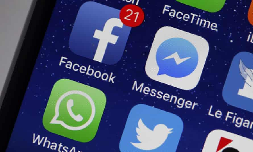 Mobile phone showing Facebook and Messenger icons