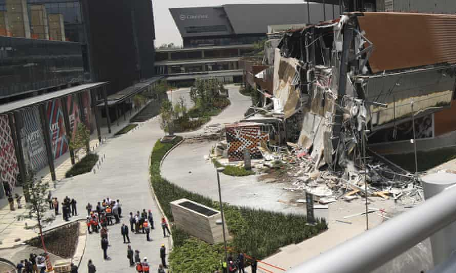 The Artz Pedregal shopping mall stands partially collapsed in Mexico City, on 12 July.