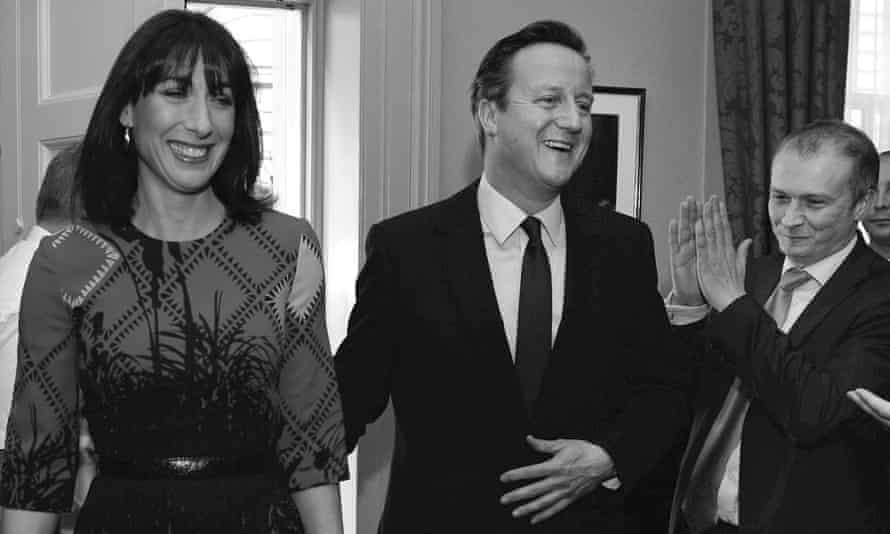 Chris Martin, right, welcomes David and Samantha Cameron back to No 10 after the Conservative victory in May's general election.