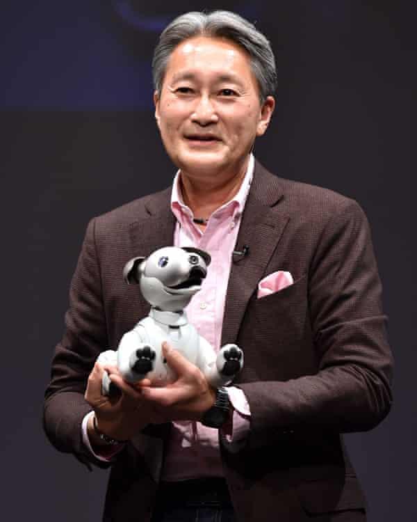 Kazuo Hirai with Aibo, Sony's robotic 'entertainment dog'.