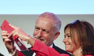 Jeremy Corbyn poses for a selfie with Slovenian member of the European parliament, Tanja Fajon, prior to a meeting of European socialists.