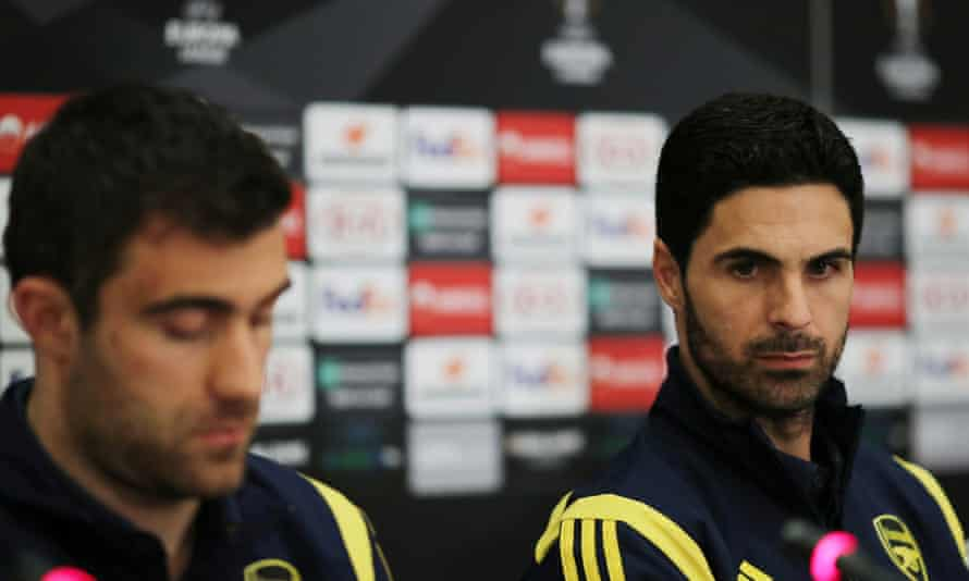 Arsenal's manager, Mikel Arteta (right), and Sokratis Papastathopoulos field the questions at the Olympiakos ground.