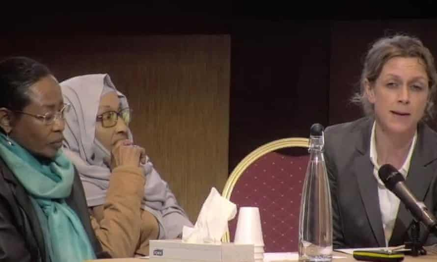 Wafa, left, and Hayat Elsanosi, centre, pay tribute to Fathia Ali Ahmed Elsanosi at the Grenfell Tower inquiry