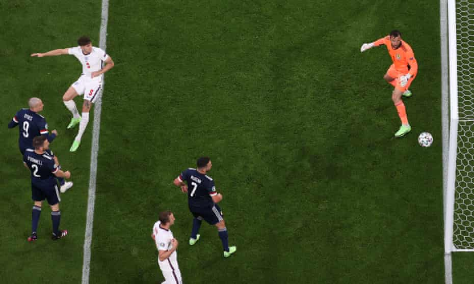 All eyes are on the ball as a header from England's John Stones hits the upright.