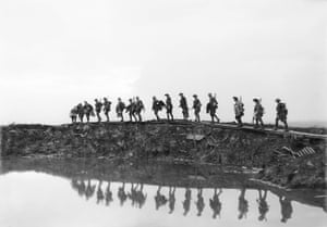 'Supporting troops of the 1st Australian Division walking on a duckboard track near Hooge, in the Ypres sector. They form a silhouette against the sky as they pass towards the front line to relieve their comrades, whose attack the day before won Broodseinde Ridge and deepened the Australian advance.' 5 October 1917
