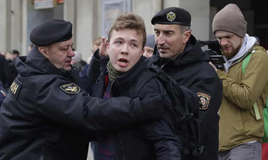 Police detaining Roman Protasevich