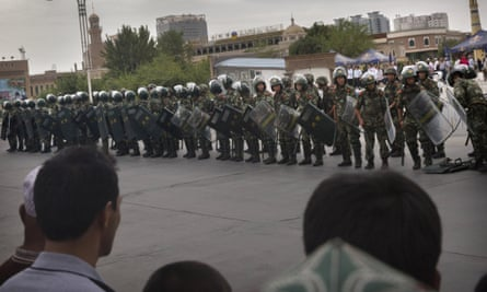 Chinese soldiers in riot gear stand outside a mosque in Kashgar, in Xinjiang province.
