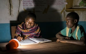 Pupils prepare for exams at night, using solar lamps, inGumbi library, Malawi