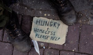 Hungry and homeless, please help sign at man's feet