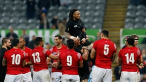 Ma'a Nonu is carried by teammates through a guard of honour after his 100th cap for New Zealand.
