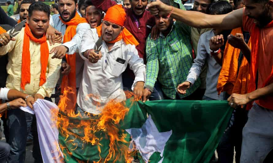 Demonstrators burn Pakistan's national flag during a protest against the Uri army base attack in Kashmir last month.