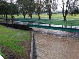 Stormwater drain filling in Lismore after days of heavy rain.