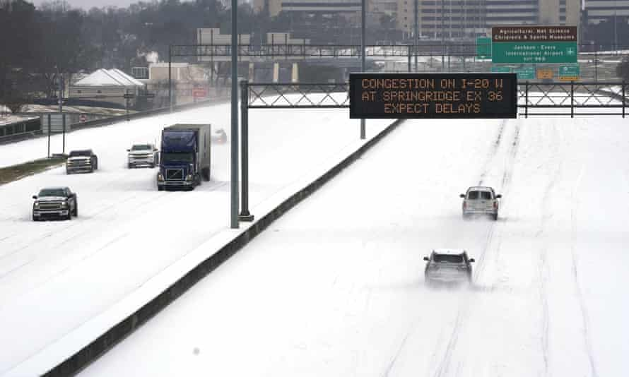 Drivers in Mississippi drive through highways thick with snow during extreme weather in February