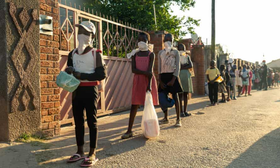 A queue forms outside Samantha Murozoki's home in Chitungwiza.