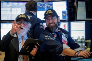 Traders work on the floor at the New York Stock Exchange