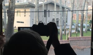 Gio Ponti's son takes a picture of the villa from a house across the street.