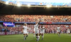 Megan Rapinoe celebrates after scoring her team's first goal in Paris