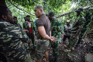 Gabon national park rangers make a mock arrest during a training exercise.