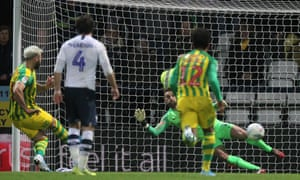 West Brom's Charlie Austin (left) beats Declan Rudd from the spot to settle their Championship match at Deepdale.
