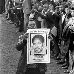 A man holds a picture of South African students leader Steve Biko, at his funeral in King William's Town, 1977.