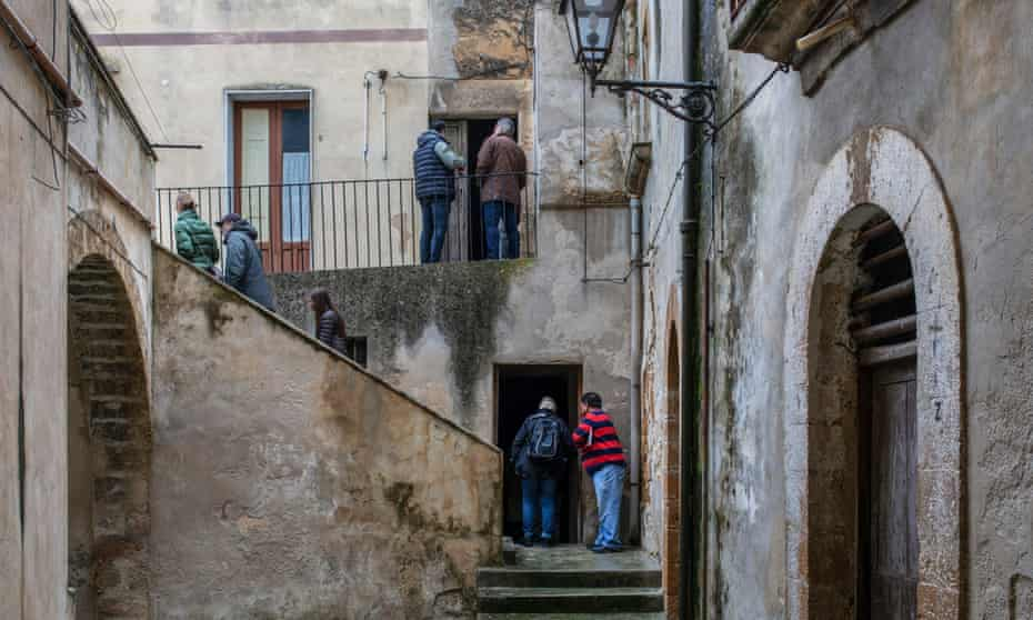 Potential buyers inspect houses for sale in Sambuca.