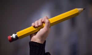 A giant pencil is held up at a vigil outside The French Institute in London on 9 January 2015 for the 12 victims of the attack on the Paris offices of satirical weekly Charlie Hebdo.