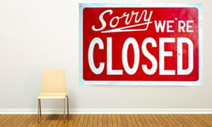 A frame hanging in an art gallery with a 'Sorry, We Are Closed Sign' inside