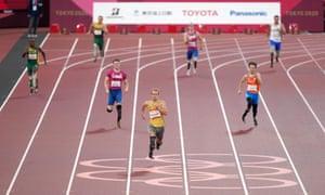 Germany's Johannes Floors (centre) wins the men's 400 m T64 final.