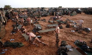 French soldiers of the Belleface Desert Tactical Group set up a temporary forward operating base for the night in the during Operation Barkhane, Ndaki, Mali