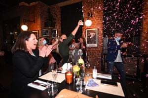 Patrons and staff celebrate at Angus & amp;  Bon New York-pancake in Melbourne right after midnight.